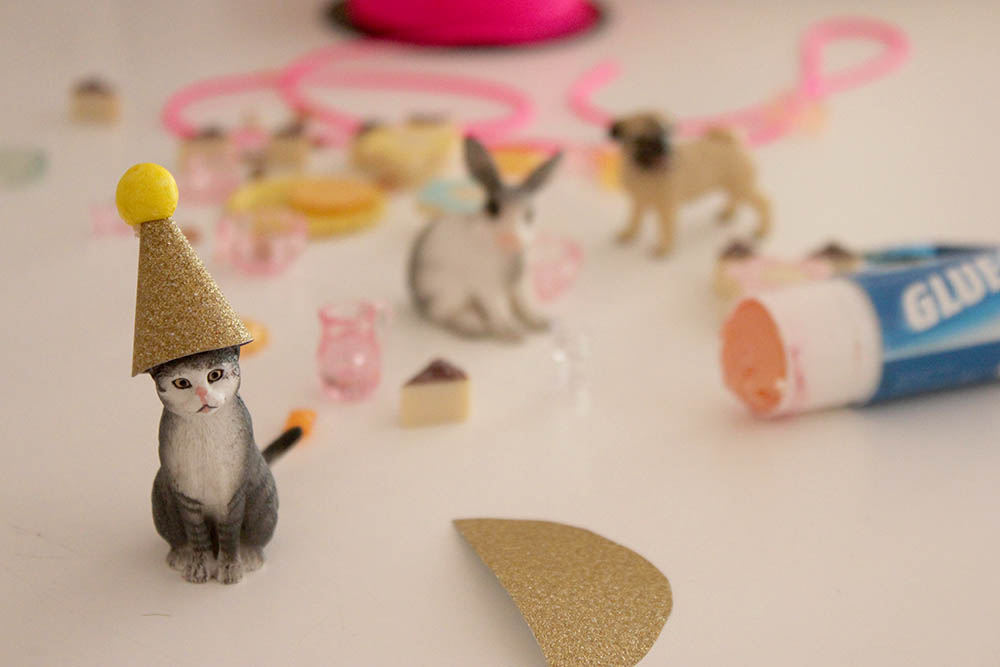 dd3200dee9b I bought gold glitter paper from a craft store and made tiny party hats and  crowns for the animals. So cute! I also made bunting with some purple  glitter ...